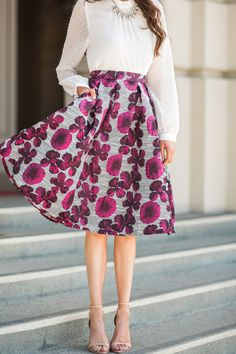 Midi skirts are one of our favorite pieces to layer, and this fuchsia floral striped skirt is no different! This skirt even has pockets for all of your essentials! 100% Polyester. Model is wearing siz
