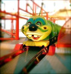 Toothy - smiling caterpillar carnival ride