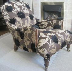 Low Victorian armchair. Reupholstered & repaired.