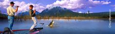 """www.beebower.com  Every fisherman's had """"The Big One"""". It's the one that almost got away. Dad wanted to capture that on film.   So you create it, especially if you're Hugh Beebower. Dad took one photo of the fishermen, the bass and the trees in the background at a lake in Texas and merged it with mountains he shot near the Icefields Parkway in Canada. The result? A fisherman's dreams come true in """"The Big One"""".    #fishing #bass #thebigone #texas #canada"""