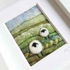 Original textile art by Shropshire-based artist Maxine Smith. A needle felted and embroidered miniature picture inspired by the natural environment. A lush green hillside with quirky sheep. Textile artist Maxine Smith takes inspiration from the dramatic landscapes, hillsides and