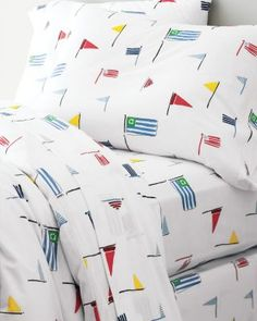 Nautical Flags Jersey-Knit Bedding  in a regatta of bright colors by Garnet Hill. #nautical