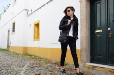 Pair a black leather moto jacket with black slim trousers for a standout ensemble. For footwear go down the classic route with black leather tassel loafers.  Shop this look for $94:  http://lookastic.com/women/looks/biker-jacket-oversized-sweater-tassel-loafers-crossbody-bag-sunglasses-skinny-pants/7330  — Black Leather Biker Jacket  — White Knit Oversized Sweater  — Black Leather Tassel Loafers  — Black Leather Crossbody Bag  — Dark Brown Leopard Sunglasses  — Black Skinny Pants