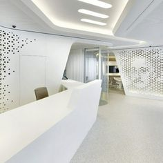 The_contemporary_reception_desk_in_white-Modern Bank Interior Design - Raiffeisen in Zurich