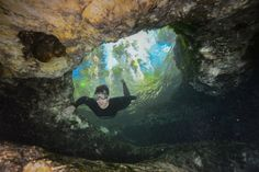 Expedition member Joe Guthrie dives through a tunnel in a Chassahowitzka spring.
