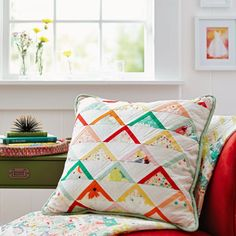Solids and bright prints are a fresh way to showcase 90° triangles in this contemporary pillow. Fabrics are from the Rapture collection by Pat Bravo and the Pure Elements solids collection, both for Art Gallery Fabrics [1]. [1] http://artgalleryfabrics.com