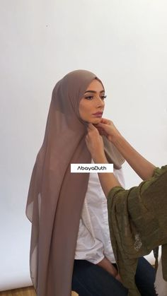 . In this #hijabtutorial our model is wearing our Latte Georgette Hijab along with our Hijab Cap and Volumizer Scrunchie underneath which can be purchased seperately.  This look can be achieved with any hijab.  Shop the look online at www.abayabuth.com  NB: There is more pins than usual to keep the pleats and hijab secure. The pins do not make the hijab uncomfortable (our model did a photoshoot in this hijab style.)