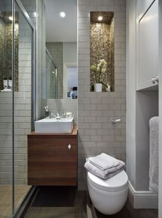 Tiny en-suite shower room with oodles of character and storage. Bathroom design by Nicola Holden Designs.