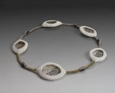 """felt necklace Thread of Thought N109 - 2012, 11"""" x 11"""" x 1"""" merino wool fiber, repurposed brass wire, silk fabric, cotton thread; needle and wet felted, naturally dyed, free-motion embroidered, hand stitched"""