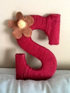 Some yarn, a large wooden letter, your favorite flower/bead/ribbon, and some glue and this would be an easy craft.