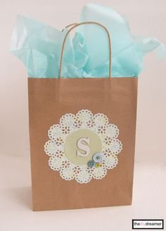 Doily gift bag. Can use any object in the inside f circle. Possibly piece of an…