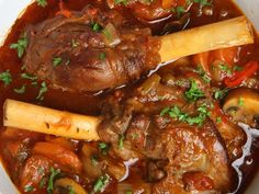 Made with olive oil, lamb shanks, Pinot Noir or Burgundy, Dijon mustard, balsamic vinegar, salt, black pepper, fresh rosemary, fresh parsley, garlic, mushrooms, carrot, onions | CDKitchen.com