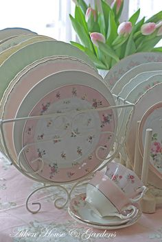 I love the idea of mismatched dishes in light colors,,, Shabby chic dishes