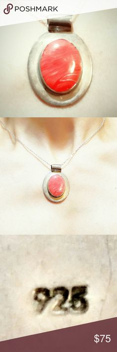 """VTG Pink Coral Sterling Silver Pendant Necklace Beautiful Vintage Pink Coral Sterling Silver Pendant Necklace. Native American crafted. Rare undyed large Pink Coral Cab set in Sterling Silver. Hallmarked on the back. The pendant measures approximately 1.6"""" x 1.25"""" and weighs  around 10 grams. The necklace is about 18"""" long. Great vintage condition with very minor signs of wear. Amazing color! Vintage Jewelry Necklaces"""