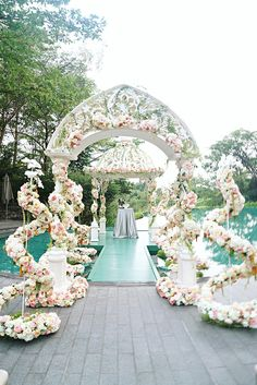 Gorgeously beautiful white, pink and green floral decor for solemnisation // Godzilla and King Kong ruled the photo booth at Chen Herng and Wei Wei's wedding at Capella Singapore, and we knew the moment we laid eyes on the larger-than-life setup that this would be one epic wedding.