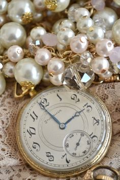 Love the crystals, beads and pearls and the vintage timepiece.