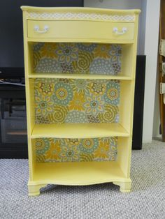 """Can't find the """"before"""" picture. It was stained dark wood.  The back of the book case is fabric."""