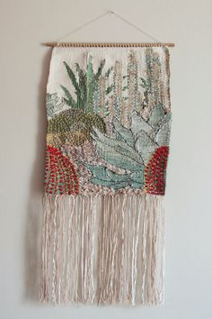 Add a little botanical style to your living space or office with this gorgeous one-of-a-kind hand woven Cactus Garden wall hanging. Woven with a selection of carefully picked hand spun, hand dyed yarn from Ireland and Scotland, and metallic thread, and finished with embroidered detail.