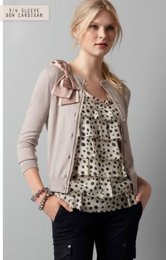 Add a bow to a cardigan's shoulder, like in this Ann Taylor Loft version