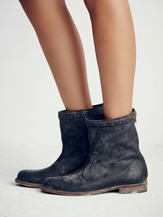 Spring Valley Ankle Boot   Distressed leather ankle boots with a coveted worn finish. Hand-stitched detailing at topline, styled cuffed for a slashed effect. Full back-zip closure.