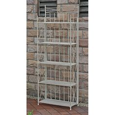 @Overstock.com - Folding bakers rack is great for indoor or outdoor use Iron shelf features an antique white finish with EP rust protection Versatile rack is perfect for indoor storage or as an accent piecehttp://www.overstock.com/Home-Garden/Large-5-tier-Iron-Folding-Bakers-Rack/2992492/product.html?CID=214117 $159.99