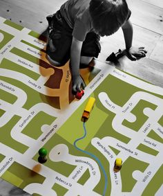 The I am Here play mat is custom-designed to their neighbourhood and is professionally printed on 10oz vinyl (deluxe 18oz vinyl is available). Easy to keep clean and store, the play mat can be wiped with a cloth and rolled up when playtime is over.