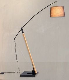 Oyla - This stylish lamp, designed by Australian designer Paul Mulhearn combines metal elements with natural beech to create a beautiful lighting feature for your living space. Finished with a handmade textured linen shade, the Olya will add functional style and atmosphere to contemporary interior environments