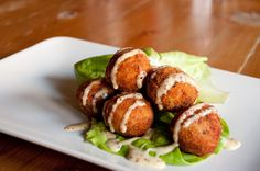 These are the perfect party snack: crispy sauerkraut fritters dipped in sweet mustard sauce. You can fry them ahead of time and serve them at room temperature.