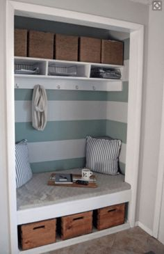 Cute little makeshift mudroom/sitting area with turquoise and white stripes and baskets