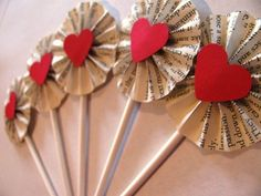 Paper Wheels made out of book pages with heart centers. Perfect for Alice in Wonderland party.