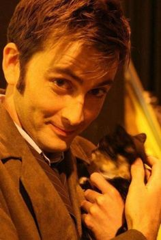 I didn't think that David Tennant could get more adorable, and then they photographed him snuggling a kitty. I am so jealous of that cat!