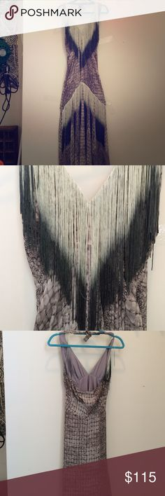 Beautiful Fringe Boho Dress Halter top, zipper on side. Lined.  Ombré long fringe on top and bottom.  Amazing dress.  Colors are Black, gray, silverfish light gray, and a grayish purple color. This is definitely a beautiful unique eye catching dress. Never worn. Chico's Dresses Maxi