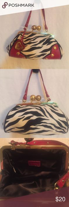 VINTAGE Zebra Purse👛 This small classy purse is canvas with vinyl emboss trim. Inside is clean. Has round kissing lock with one short embellished handle that can be hidden inside. Excellent condition 😘 XOXO Bags Clutches & Wristlets