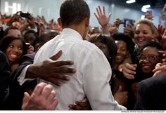 Feb. 23, 2012: President Obama greets audience members at the University of Miami Field House in Coral Gables, Florida.