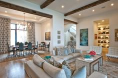 Layout, lighting, wood beams and pops of teal