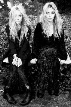 Mary-Kate and Ashley Olsen in black dresses and black boots