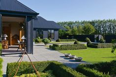 Hard to believe that this magnificent house and garden, located in the Wairarapa region of New Zealand, owned by New Zealand landscape designer, Lyn Eglinton, was nothing but a bare paddock in Modern Barn House, Modern House Design, Modern Farmhouse Design, Black House Exterior, New Zealand Houses, Shed Homes, Home Fashion, Style At Home, House Colors