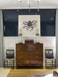 Image found on Pheobe Howard. A high gloss navy wall using a color similar to Benjamin Moore Hale Navy HC-154