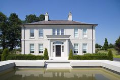 Water view of Georgian Inspired Country House by Paul McAlister Architects Georgian Architecture, Architecture Design, Georgian Buildings, Computer Architecture, Architecture Portfolio, Style At Home, Ireland Homes, House Ireland, Georgian Style Homes