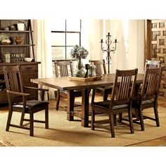 This rustic mission style dining set features a solid wood construction with natural wood characters and dark metal brackets, includes 20-inch leaf for additional seating, The leatherette upholstered seating makes them luxurious and comfortable.