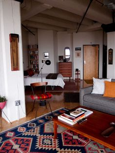 A more rustic approach to Spanish and Southwest -- white walls, dark wood. Decor ideas