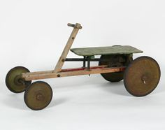 Handmade go carts from wood and mower wheels and old bikes