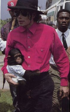 Michael Jackson, not sure if this is Bubbles when he was little, or a different chimpanzee.