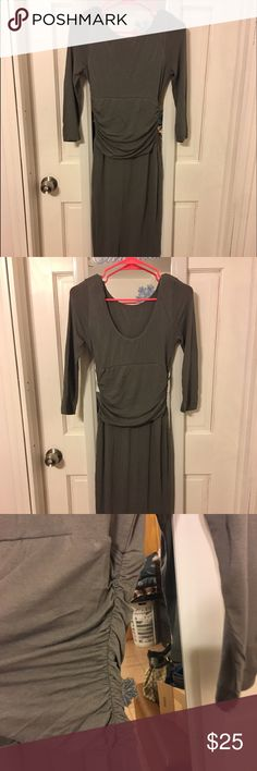 Gray Bodycon Dress Very firm fitted with stretch on the fabric. Fully lined. Scoop neck and lower scoop on back of dress. Ruching on waist of dress. 3/4 sleeve. Slate gray in color. Used once. Pet and smoke free home. Dresses Midi