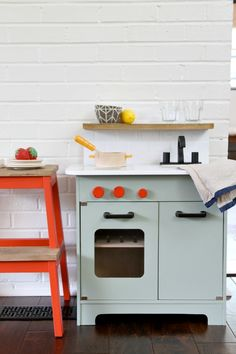 refinish a play kitchen to match your home decor - add tile, open shelves, etc.