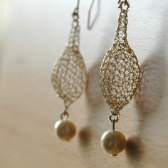 """The earrings in a drop shape were created using a crochet hook and a fine 14K gold filled wire, the earrings are 2"""" (5cm) long. The earrings in drop shape are bright, dangle, eye catching, unique and"""