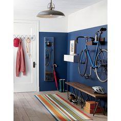 Bike shelf on blue wall
