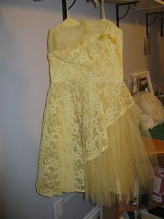 Yellow tulle and lace prom dress.  Asymmetrical lace erupting in a tulle pouf!