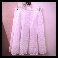 Beautiful Tahari white pointelle skirt I bought this lovely Tahari skirt for Easter and wore it just the once!  Bought as a size 4 and had it taken in a bit, would better fit a 2.  100% cotton, gorgeous pleating and pointelle material.  Side zip with hook and eye closure.  Fully lined as seen in pic.  Like new condition!!  🌹 Tahari Skirts