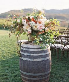 beautiful floral centerpiece on a barrel